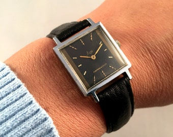 """Vintage Women's watch """"RAY"""" (Luch) made in Ussr. Square Dial with gold numerals,this Soviet watch comes with brand new leather band!"""