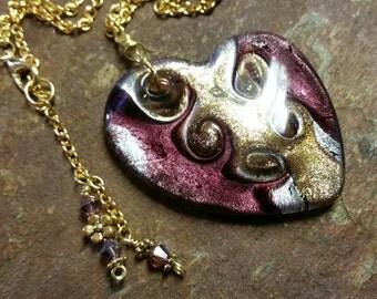 lampwork heart pendant necklace. purple dichroic glass heart necklace. purple and gold lampwork heart necklace.
