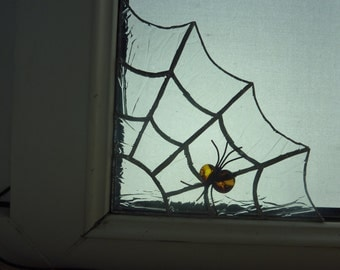 Stained glass spider's web and spider