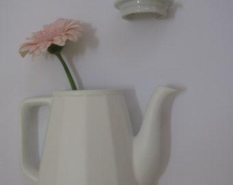 Half white porcelain wall vases.