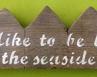I Do Like To Be Beside The Seaside beach hut terrace made from recycled wood