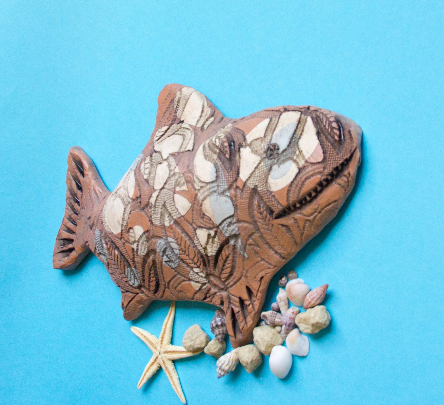 Request a custom order and have something made just for you for Ceramic fish sculpture