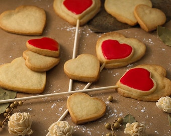Double heart cookies on a stick.