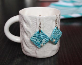 Glazed ceramic handmade earrings with natural pearl