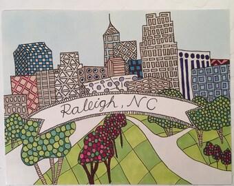 Raleigh skyline - single postcard