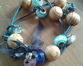 Leather braclet with wood and glass beads.