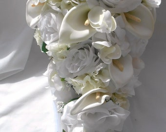 Silk cascade bridal bouquet made of callas ,roses, orchids and hydrangeas in white