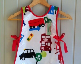 Toddler Boy wipe clean tabard style apron for messy play times.