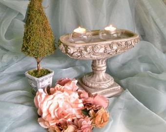 Floating tea candle holder