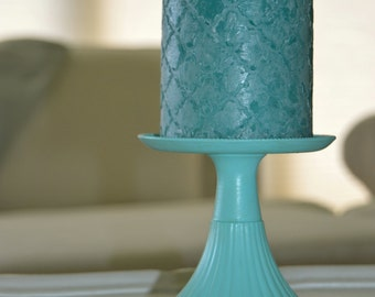 an aqua color charming shabby chic candlestick