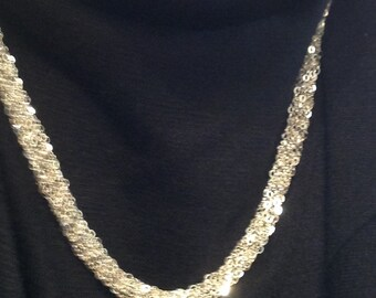Elegant woven sterling silver necklace.