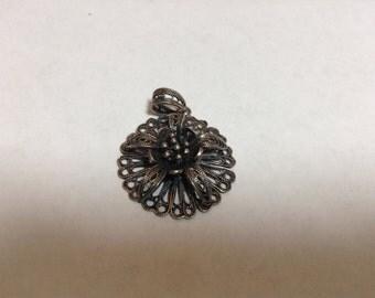 Antiqued sterling silver rose pendant