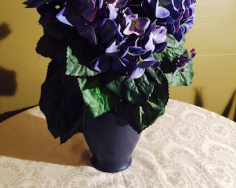 Silk Blue Hydrangea with green Foilage in blue vase