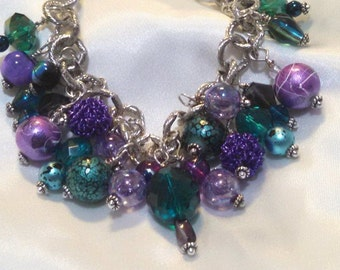 Made to order beaded bracelets in any or all colors using pearls, crystals, glass & other semi precious stones w/gold, silver or stainless.