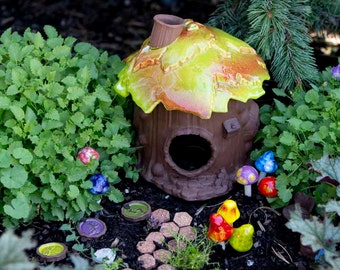 Fairy Garden Starter Collection. Fairy Garden Accessory. Includes: Ceramic Fairy House, Pixie Pavers, Mini Mushrooms, Bird Bath, and a Sign.