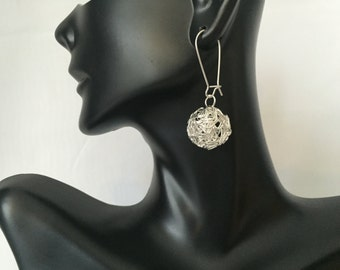 Silver hallow ball earrings