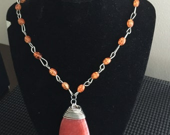 Coral colored necklace