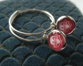 Sterling Silver Hoop Poison Charm Earrings from Hoolala