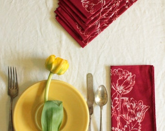 four red tulip napkins