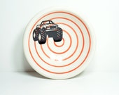 a small dish, with a monster truck print on red-orange pinstripes, made to order / pick your colour