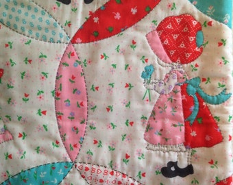 Vintage fabric crib size quilt - red and pink