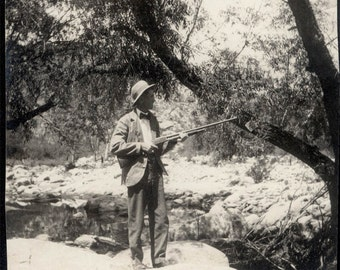 Vintage photo 1910 Man by Creek wears Bow Tie holds Winchester Rifle Gun