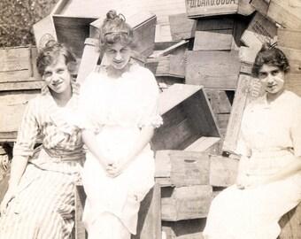 vintage photo 1917 Pretty YOung Women Sit in wooden Box Bicarb Soda Box