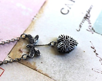 dragonfly heart. locket necklace. silver ox with filigree locket