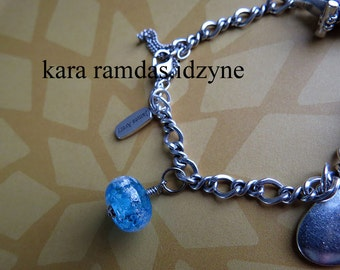 Memorial bead dangles for charm bracelets, bangles, etc. Made with human or pet hair, or pet ashes.