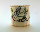 Bluebird of Happiness cloth cuff bracelet, hand stitched with freehand drawing