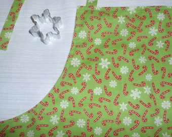 Child size apron - snowflakes candy canes reversible - snowflake cookie cutter