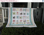 Spring Sale My Neighborhood  Appliqued Lap Quilt designed by Sweetwater and using Road 15 fabrics by Moda