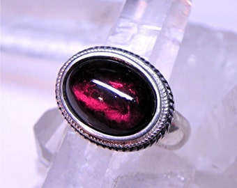 AAAA Stunning Purple Red Rhodolite garnet 14x10mm 7.25 Carats in a sterling silver ring Ready to ship.