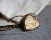 vintage. antique. romantic locket. heart necklace. valentines day. engraved. brass.