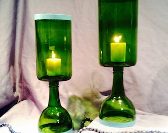 Hurricane candle holders from upcycled wine bottles. Set of two dark green with blue trim.