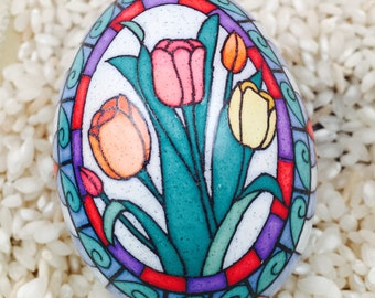 Stained glass tulips on a chicken egg