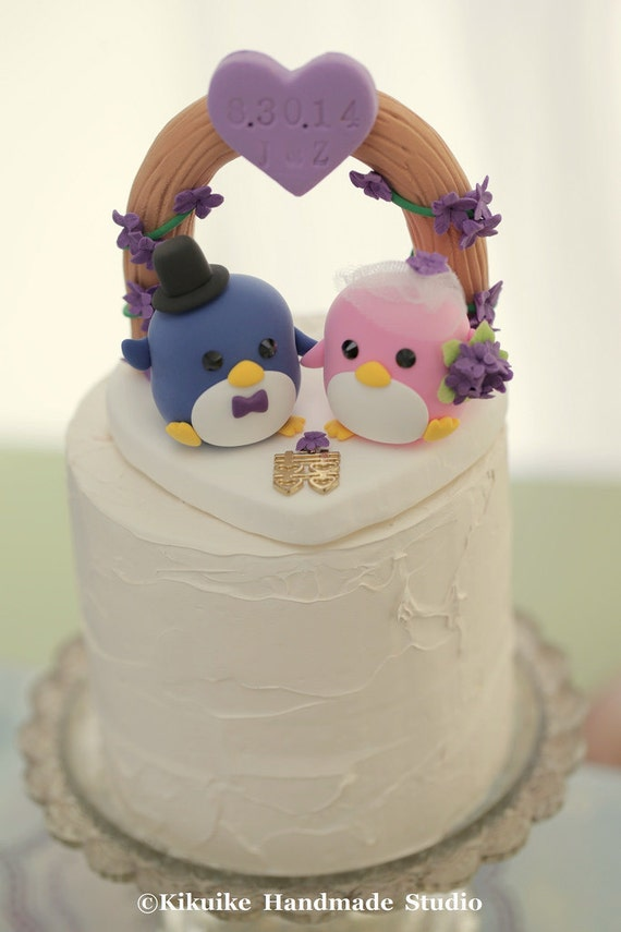 adorable wedding cake toppers penguins with flower arch wedding cake topper k431 10542