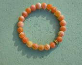 Unisex Stretch Bracelet with Apricot Agate Beads: Rhodes