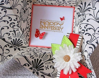 Folded Pinwheel ANNIVERSARY Card, black on white with green and red