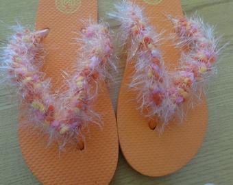 Orange fuzzy flip flops