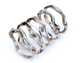 Individual hand carved organic silver ring