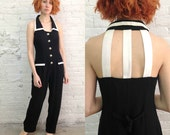 vintage 80s wide legged minimal black jumpsuit with cutout cage detail / black and white minimalist