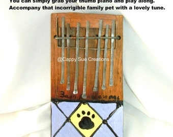 Pet humor sing me the song of your people musical instrument thumb piano kalimba