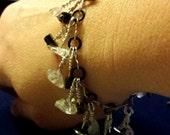 Hematite and quartz crystal bracelet