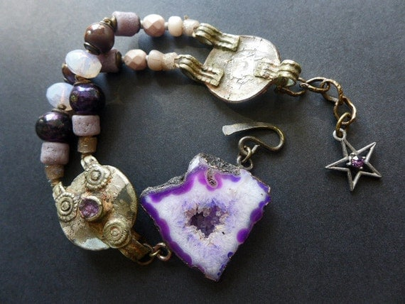 Ubuntu . Rustic assemblage bracelet in shades of purple violet with kuchi and druzy agate slice.