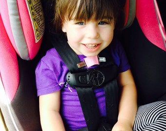 Harness Helper prevents kids from escaping car seat & stroller 5pt harnesses! Keeps kid's backpacks on, too! Holiday road trip safety.