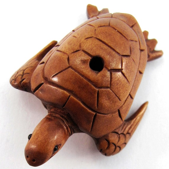 Sea turtle hand carved boxwood ojime bead from