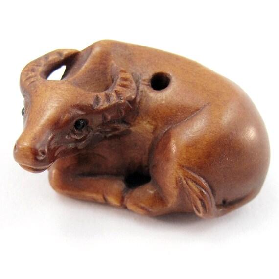 Buffalo or ox bead hand carved boxwood ojime