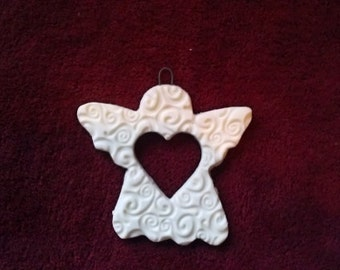White Porcelain Angel Ornament with Heart Cutout