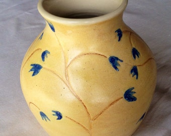 Ceramic vase, raw honey glaze with electric blue buds